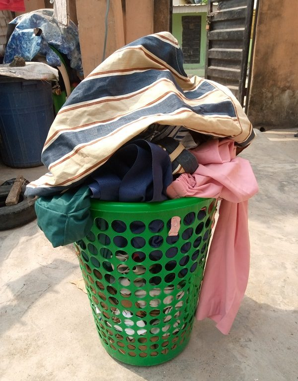 Style Patterns Clothes in a Basket outdoors 600px