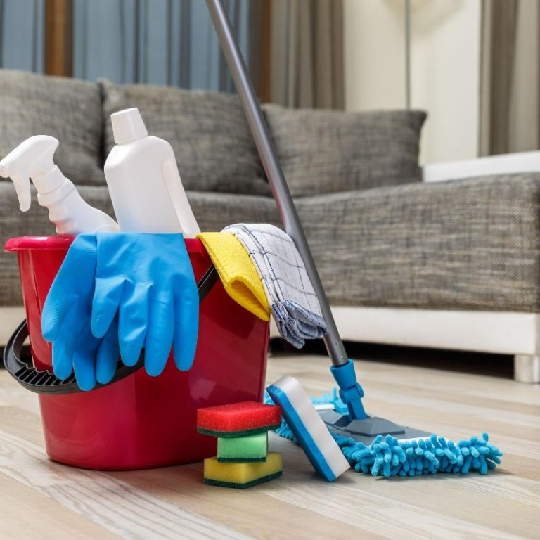 cleaning items with blue gloves