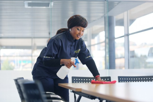 lady cleaning office desk